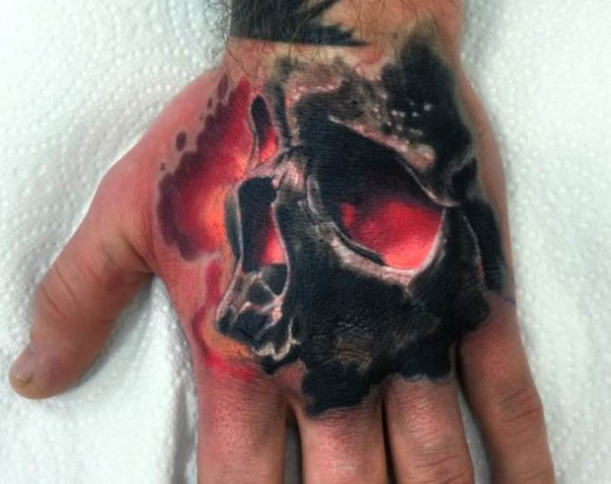 tattoo-on-a-hand-at-men-gtyj546u35y